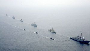 A Burke class destroyer leads an exercise with Peruvian submarines.