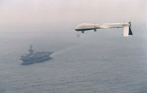 Predator UAV flies above the aircraft carrier USS Carl Vinson (CVN 70) on  Dec. 5, 1995.