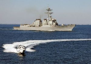 Arleigh Burke-class destroyer in a simulated small boat attack exercise.