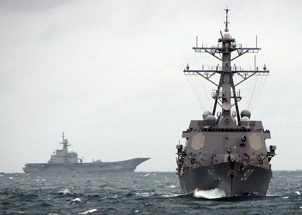 Guided-missile destroyer USS Chafee (DDG 90) leads the Royal Thai Navy aircraft carrier HTMS Chakri Naruebet (CVH 911).