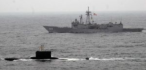 Peruvian submarine underway with the guided-missile frigate USS Kauffman.