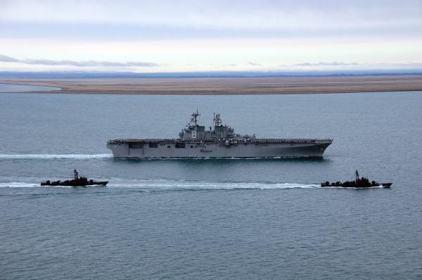 The amphibious assault ship Pre-Commissioning Unit Makin Island (LHD 8) is escorted by two Chilean Navy missile craft, Casma (LM 30) and Chipana (LM 31), as it enters the Strait of Magellan.