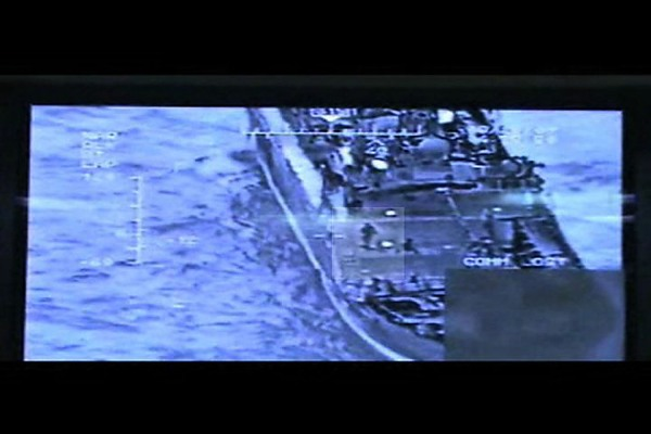Somali pirates aboard Motor Vessel (M/V) Win Far fire upon a U.S. Navy SH-60B Sea Hawk helicopter.