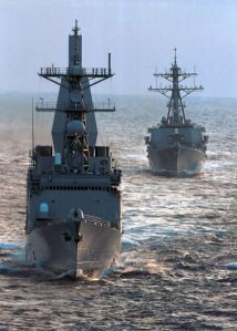 Spruance class destroyer USS Arthur W Radford leads the Arleigh Burke class USS Mahan.