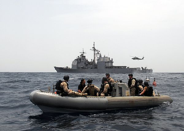 The guided-missile cruiser USS Anzio (CG 68) prepares to investigate a skiff during a maritime security operation in the Gulf of Aden.
