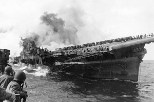 USS Franklin (CV-13) burning and listing after a Japanese air attack, 19 March 1945.