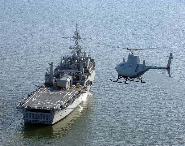An older photo of an RQ-8A Fire Scout UAV preparing to land aboard the amphibious transport dock ship USS Nashville (LPD 13). Nashville is being decommissioned after more than 39 years in the U.S. Navy.