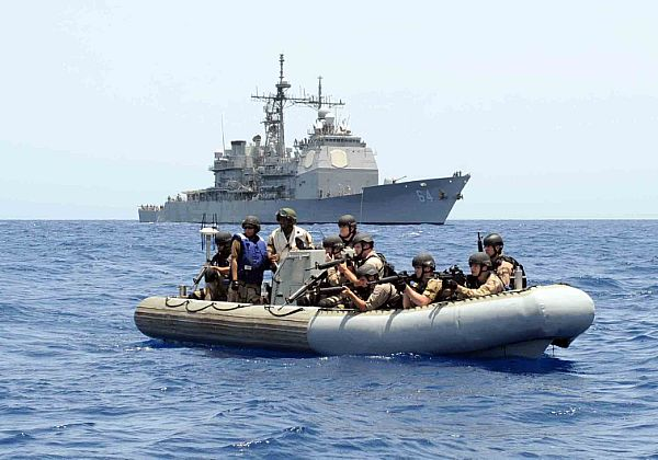 A visit, board, search, and seizure team from the guided-missile cruiser USS Gettysburg (CG 64) patrols the Gulf of Aden near a suspected pirate vessel.