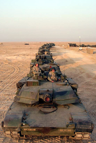 A column of M1 Abrams tanks from B Company, 1st Battalion, 35th Armor prepares to roll out on a training mission in Kuwait.
